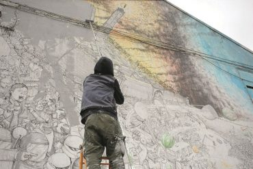 Blu street artist working